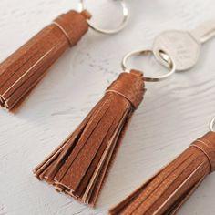 How to Make a Keychain Tassel (Craft Gawker) Leather Tassel Keychain, Leather Cuffs, How To Make Leather, Leather Scraps, Fabric Scraps, Scrap Fabric, Cork Fabric, Diy Keychain, Leather