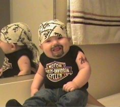 Biker baby costume.Haha I would never dress my kid like this...but it's hilarious.
