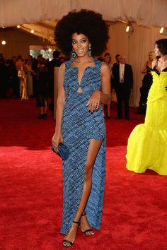 Solange Knowles stuck to her signature style with a Kenzo printed dress. #MetGala
