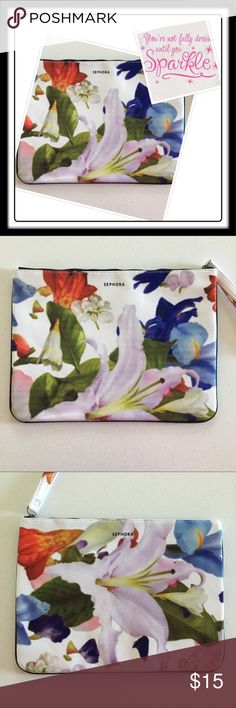 "Sephora Cosmetic Bag Never been used. Sephora lined Makeup Bag, flower design, with zipper. The material of this bag is a bit foamy that I'm certain a tablet or portable device may be stored in it. The measurements are 13.5x10"". Sephora Bags Cosmetic Bags & Cases"