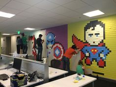 San Francisco-based designer Ben Brucker decided to freshen up the boring plain walls of his workspace and created this Superhero Post-It mural by sticking more than 8000 square sticky notes on the walls. Final result is pretty awesome even tough it's a temporary artwork.