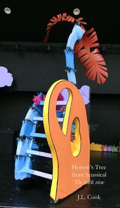 """Seussical the Musical: Mayzie/Horton's Egg, Nest and Tree. Back view showing the ladder. The orange """"Who-shape"""" visually camouflaged the tree when it was turned for the Whoville scenes and served as a rail for climbing. J.L. Cook"""