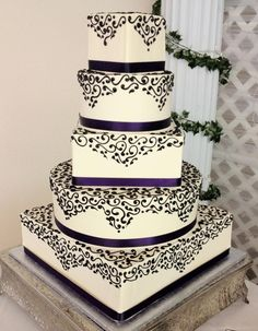 Black on White Five-Tier with Scrollwork on alternating Round and Square tiers