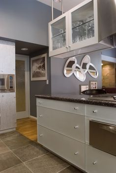 Contemporary styled kitchen. Hanging cabinet. Stainless steal. Done by Authentic Designs and Remodeling