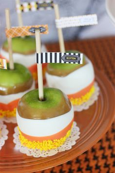 Halloween party candy apples - picture only.  Check out this recipe from Sunset for making triple dipped apples: http://www.myrecipes.com/recipe/white-chocolate-toffee-crunch-caramel-apples-10000001110238/