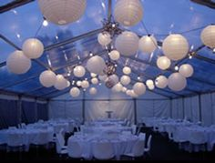 I might use paper lanterns to define the dance floor space- much like this...