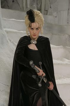 """lillithblackwell: """" Michelle Dockery as Susan Sto Helit in """"Terry Pratchett's Hogfather"""", 2006 """" This is the closest thing I have to aesthetic desires. Goth women wielding Death's sword."""