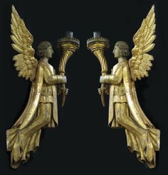 """LARGE PAIR OF ITALIAN CARVED AND GILDED ANGELS each holding an uplifted torch with oil lamp fitting, 45""""h  each holding an uplifted torch with lamp."""