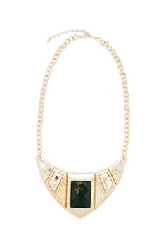 This striking necklace features a segmented bib of hammered gold with a large rectangular emerald stone in the center. Gold chain and lobster clasp complete the piece, making it ultra wearable but still unforgettable.