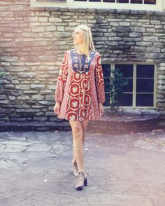 You'll be smiling all day in this caftan style medallion print.   Wear a boho headband and some fringed booties for the perfect outfit.