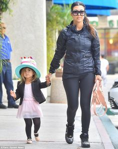 Kardashian day out: Sister Kourtney was also seen following Kim and Nori, as she held hands with her daughter Penelope