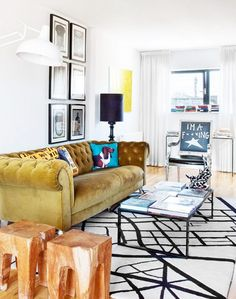 Mustard chesterfield sofa with black and white rug