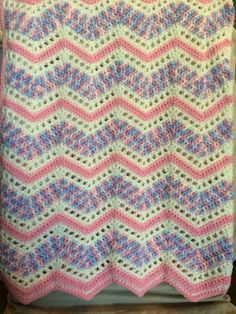 Playful ripples throw by red heart made for a baby girl.