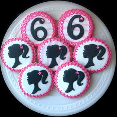Barbie Silhouette and Number decorated cookies in hot pink and black $ 48 - love the pale, pale stripe in the icing!