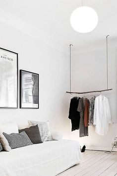 White bedroom - love the cloth rack
