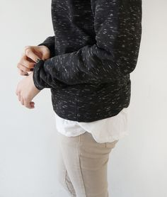 beige jeans + white shirt + speckled sweater