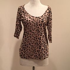 LEOPARD TOP Super cute fun top with open back and elastic criss-cross bands in back. Charlotte Russe. Never worn Charlotte Russe Tops