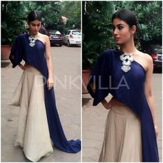 Mouni Roy attended an event earlier today looking lovely in Ezra. Her midnight blue dipped drape top was paired with a beige skirt and styled with a . Indian Fashion Dresses, Indian Outfits, Fashion Outfits, Ethnic Outfits, Western Dresses, Western Outfits, Stylish Dresses, Nice Dresses, Lehenga Designs