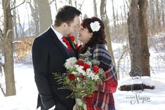 seeing red at this lovely elopement winter wedding at the cozy and romantic Little Log wedding Chapel in Niagara