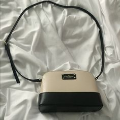 NEW Kate Spade Hanna Resilient pebbled leather   Classic Kate Spade Porcelain and Black color combo  Adjustable leather strap to wear as a shoulder bag or as a cross body   Current season Kate Spade  New with Tags - never been worn!  Retails for $198.   Price is FIRM!!!  NO TROLLS. NO LOWBALLERS. These messages will be ignored.   My friend gets an employee discount so I am pricing these as LOW as I possibly can. If the bag doesn't sell, I will return for a full refund. kate spade Bags…