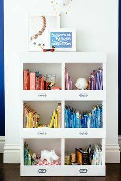 Organize books by color or theme - SO darling! {The Cameron Bookshelf from @potterybarnkids makes this so easy!} #projectsibling