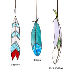 Hang one of these handcrafted, stained glass feathers in a window to catch the light.
