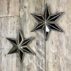 Decorative Star Mirror Pair A pair of decorative stars with mirrored detail. H 29 cm x W 29 cm