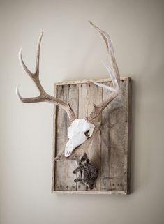 Art carved reproduction mule deer skull on a custom weathered wood wall plaque with wood skull rest. Check out Nussbaum Taxidermy on facebook or on the web for other products.