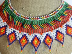 Many colors, but main colors are purple, red, green, and white. Diy Accessories, Bead Crochet, Diy Jewelry, Collars, Rainbow, Etsy, Beads, Pattern, Angeles