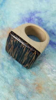 Olcay made this wooden ring November 2016 Maple & Black Palm + Acrylic varnish + Carnauba