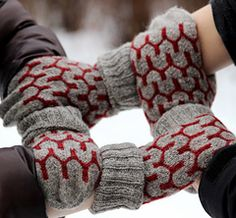 These decorative mittens will keep your fingers warm during the winter. The pattern combining stranded knitting and simple cables gives a big effect with little effort.