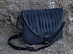 https://www.cityblis.com/4345/item/13606  Black Pleated Elegant Women Bag - $69 by XTHISMO  Black elegant bag made of fabric plush and black snakeskin textile leather. It has a pleated cover with clasp closure, and zipper under the cover. Adjustable shoulder strap, can be worn as shoulder and over-shoulder bag. Black linen inside with inner pocket.    Size: 31x24x4 cm  Cleaning: handwa...