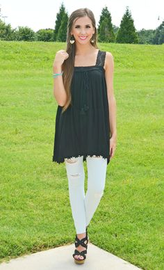Obsessing over this black tunic! Pair with some white skinnies and wedges for a night out with the girls!