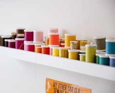 Picture frame ledge to hold spools of (awesomely colored) thread - Brett Bara studio / Design Sponge