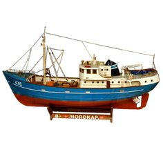 20th Century  Painted ship model of 'B.Nordkap' enclosed in glass case with dramatic background of the coast.