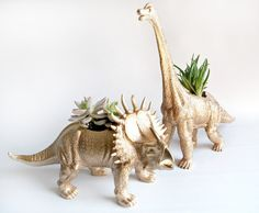 DIY Dinosaur Planter It is the time for giving but buying lots of gifts can mean spending lots of money so I love a budget friendly DIY that looks like a million bucks. This year I was looking for a cute gift for my so… Dinosaur Plant, Make A Dinosaur, Dinosaur Gifts, Dinosaur Birthday, Dinosaur Projects, Dinosaur Wedding, Plastic Dinosaurs, Plastic Animals, Super Cute Animals