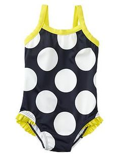 A - based on reviews, she'll actually need a 3T in this one; Polka dot ruffle-trim one-piece