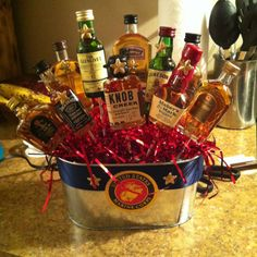 Liquor bouquet! I made this for Joes promotion and it was super easy! You need: 1 pot Ribbon of your choice 10-12 mini liquor bottles Glue gun and glue sticks  The stuffing to go in the pot Floral styrofoam  And any other small decorations, such as the starts I added to the bottles.