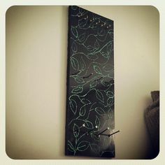 A jewelry hanger my husband and I made. MDF with black enamel on it, felt added to the back to prevent rubbing, glitter glue freeystyle green leaves, nails, and cup hooks. Add hanger hardware and it is ready!