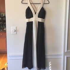 BCBG Dress Beautiful brown dress with cream straps that cross in the back. Perfect for a school dance! BCBG Dresses Midi