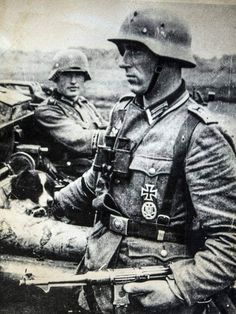 An Oberfeldwebel (Master Sergeant) of Panzergrenadier Division Grossdeutschland stands aside his field car. Inside the field car are his driver and his dog. The Oberfeldwebel here is armed with an. German Soldiers Ww2, German Army, Ww2 History, Military History, Master Sergeant, Germany Ww2, German Uniforms, Military Uniforms