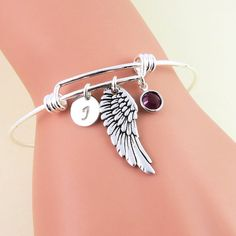 Hey, I found this really awesome Etsy listing at https://www.etsy.com/listing/386125048/silver-angel-wing-bangle-bracelet
