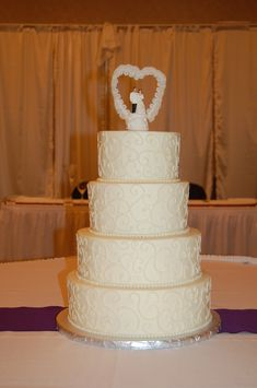 4 tier round wedding cake, side scroll piping ivory color