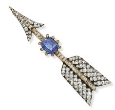 A Russian sapphire and diamond arrow brooch,The central cushion-cut sapphire set within a rose-cut diamond cluster to a pavé-set diamond winged arrow, Russian marks to pin.