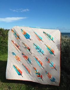 "Wonderful ""Birds of a Feather"" quilt made with blocks from the Mid Century Modern Bee and Suz from PatchworknPlay. Even the signature blocks on the back make a cheerful quilt all on their own!"