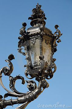 Closeup of old stylish street lantern against clear blue sky