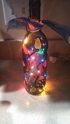 glass christmas lighted bottle