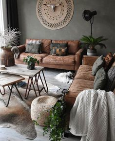 Earthy vibes. Love this room. LOOKS ABSOLUTELY INCREDIBLE, WITH THE FABULOUS LEATHER SOFA, STUNNING WALL DECOR, GORGEOUS FURNISHINGS & SUPERB DECOR!! #️⃣