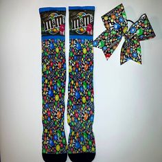 m&ms socks and cheer bow set $40 www.blingonthebows.com #cheerbows #customsocks #blingonthebows #cheerleader