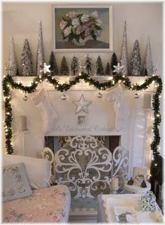 An Enchanted Cottage: Winter white, silver, and green for the mantel...